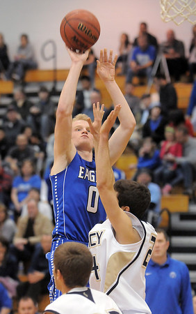 Broomfield's Dan Perse shoots the ball over Legacy's Alec McClain during Saturday's cross town game at Legacy.<br /> .<br /> January 7, 2012<br /> staff photo/ David R. Jennings
