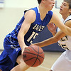 Broomfield's Evan Kihn dribbles to the basket against Legacy's Mitch McCall during Saturday's cross town game at Legacy.<br /> January 7, 2012<br /> staff photo/ David R. Jennings