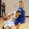 Legacy's Marcus Riddick drives the ball downcourt against Broomfield's Evan Kihn during Saturday's cross town game at Legacy.<br /> .<br /> January 7, 2012<br /> staff photo/ David R. Jennings