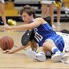 Broomfield's Austin Wood grabs for a loose ball against  Legacy's Marcus Riddick during Saturday's cross town game at Legacy.<br /> <br /> January 7, 2012<br /> staff photo/ David R. Jennings