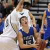Broomfield's Evan Kihn goes to the basket against  Legacy's Evo Mengist during Saturday's cross town game at Legacy.<br /> <br /> January 7, 2012<br /> staff photo/ David R. Jennings