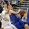 Broomfield's Evan Kihn goes to the basket against  Legacy's Evo Mengist during Saturday's cross town game at Legacy.<br /> January 7, 2012<br /> staff photo/ David R. Jennings
