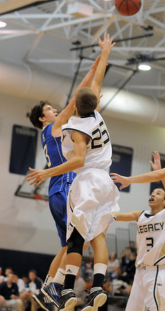 Broomfield's Nick Orgarato shoot the ball over Legacy's Mtch McCall during Saturday's cross town game at Legacy.<br /> <br /> January 7, 2012<br /> staff photo/ David R. Jennings