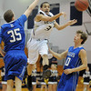 Legacy's Marcus Riddick passes the ball past Broomfield's Austin Wood and Brandon Little during Saturday's cross town game at Legacy.<br /> January 7, 2012<br /> staff photo/ David R. Jennings