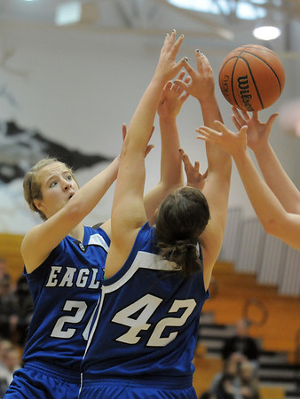 Broomfield's Meagan Prins and Stacie Hull fight for the ball during Saturday's cross town game against Legacy at Legacy.<br /> January 7, 2012<br /> staff photo/ David R. Jennings