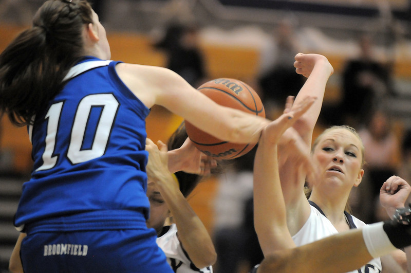 Legacy's Emily Glen and  Broomfield's Brianna Wilber fight for control of the ball with Legacy's Kailey Edwards in the middle during Saturday's cross town game at Legacy.<br /> January 7, 2012<br /> staff photo/ David R. Jennings
