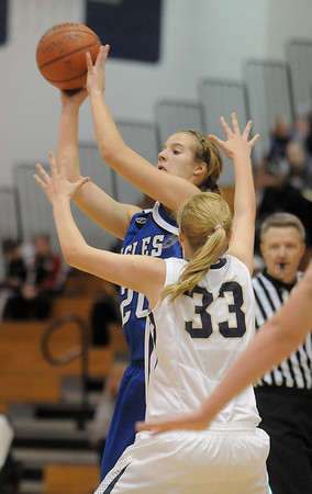 Broomfield's Meagan Prinsshoots the ball over Legacy's Courtney Smith during Saturday's cross town game at Legacy.<br /> January 7, 2012<br /> staff photo/ David R. Jennings