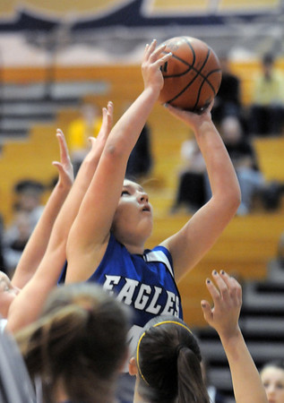 Broomfield's Stacie Hull goes to the basket against Legacy during Saturday's cross town game at Legacy.<br /> January 7, 2012<br /> staff photo/ David R. Jennings