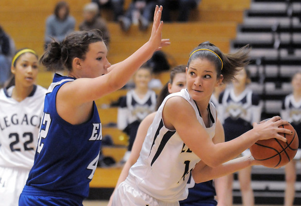 Legacy's Shayna Kuyper prepares to pass the ball around Broomfield's Stacie Hull during Saturday's cross town game at Legacy.<br /> January 7, 2012<br /> staff photo/ David R. Jennings