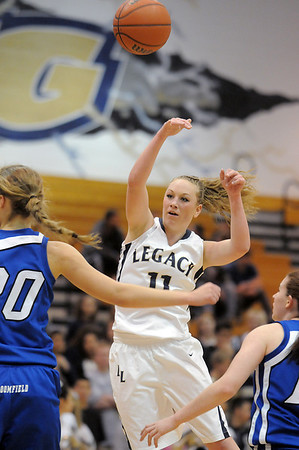 Legacy's Emily Glen passes the ball over Broomfield's Meagan Prins during Saturday's cross town game at Legacy.<br /> January 7, 2012<br /> staff photo/ David R. Jennings