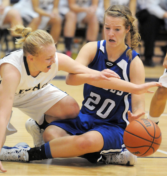 Legacy's Courtney Smith and Broomfield's Meagan Prins scramble after a loose ball during Saturday's cross town game at Legacy.<br /> January 7, 2012<br /> staff photo/ David R. Jennings