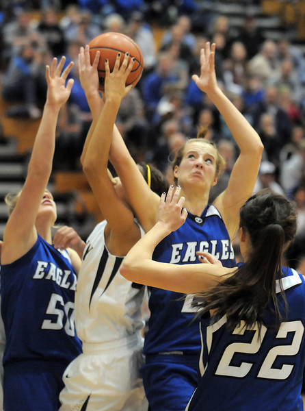 Broomfield's Meagan Prins fights for the ball against Legacy's Kailey Edwards during Saturday's cross town game at Legacy.<br /> January 7, 2012<br /> staff photo/ David R. Jennings
