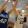 Legacy's Caitlyn Smith and  Broomfield's Stacie Hull go for the ball during Saturday's cross town game at Legacy.<br /> January 7, 2012<br /> staff photo/ David R. Jennings