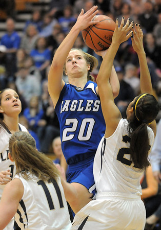 Broomfield's Meagan Prins goes to the basket against Legacy's Kailey Edwards during Saturday's cross town game at Legacy.<br /> January 7, 2012<br /> staff photo/ David R. Jennings