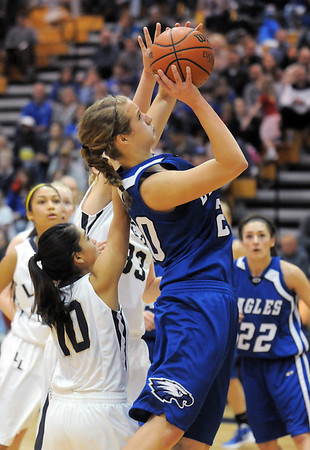 Broomfield's Meagan Prins goes to the basket against Legacy's Emiley Lopez during Saturday's cross town game at Legacy.<br /> January 7, 2012<br /> staff photo/ David R. Jennings