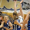 Legacy's Caitlyn Smith shoots the ball over Broomfield's Morgan Rynearson during Saturday's cross town game at Legacy.<br /> January 7, 2012<br /> staff photo/ David R. Jennings