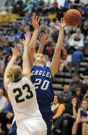 Broomfield's Meagan Prins reaches for the ball against Legacy's Caitlyn Smith during Saturday's cross town game at Legacy.<br /> January 7, 2012<br /> staff photo/ David R. Jennings