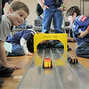 Cub Scouts watch cars finish durng the fun races at Saturday's Pinewood Derby competition for Cub Scout Troop 586 held at the Broomfield Community Center.<br /> <br /> January 22, 2011<br /> staff photo/David R. Jennings