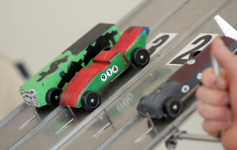 Pinewood Derby cars wait for the race to begin during Saturday's Pinewood Derby competition for Cub Scout Troop 586 held at the Broomfield Community Center.<br /> January 22, 2011<br /> staff photo/David R. Jennings