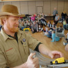 Cub Master John Svensk places a car on the track during Saturday's Pinewood Derby competition for Cub Scout Troop 586 held at the Broomfield Community Center.<br /> January 22, 2011<br /> staff photo/David R. Jennings