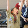Nick Page, 10, gives a big cheer at the finish line during Saturday's Pinewood Derby competition for Cub Scout Troop 586 held at the Broomfield Community Center.<br /> January 22, 2011<br /> staff photo/David R. Jennings