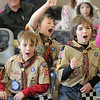 Dylan Messmer, 10, left, Nick Page, 10, and Colin Hasbrook, 11, cheer for their favorite cars during Saturday's Pinewood Derby competition for Cub Scout Troop 586 held at the Broomfield Community Center.<br /> <br /> January 22, 2011<br /> staff photo/David R. Jennings