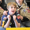 Alex Pearson, 11, left, chants for a car with Nick Page, 10, at the finish line during Saturday's Pinewood Derby competition for Cub Scout Troop 586 held at the Broomfield Community Center.<br /> <br /> January 22, 2011<br /> staff photo/David R. Jennings