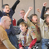 Tyler Silva, 10, left, Dylan Messmer, 10, left, Nick Page, 10, and Colin Hasbrook, 11, cheer at the finish line during Saturday's Pinewood Derby competition for Cub Scout Troop 586 held at the Broomfield Community Center. Steve Shull, left, was a finish line judge. <br /> January 22, 2011<br /> staff photo/David R. Jennings