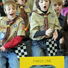 Dylan Messmer, 10, left, Nick Page, 10, cheer with Colin Hasbrook, 11, right, at the finish line during Saturday's Pinewood Derby competition for Cub Scout Troop 586 held at the Broomfield Community Center.<br /> <br /> January 22, 2011<br /> staff photo/David R. Jennings