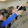 Ryan Hasbrook, 7, left, and his brother Colin, 11, put their cars on the track for the fun races after Saturday's Pinewood Derby competition for Cub Scout Troop 586 held at the Broomfield Community Center.<br /> January 22, 2011<br /> staff photo/David R. Jennings