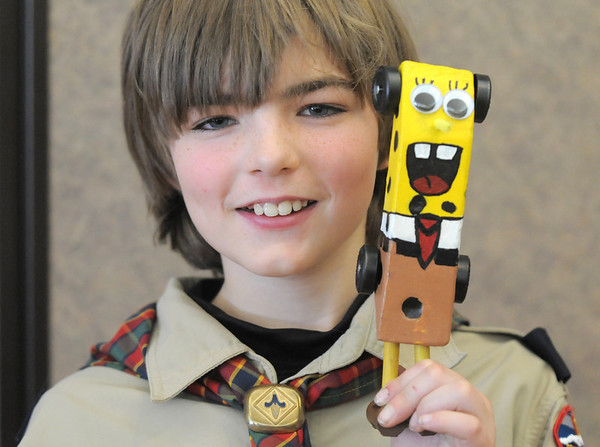 "Overall winner Colin Hasbrook, 11, displays his car ""Sponge Bob"" during Saturday's Pinewood Derby competition for Cub Scout Troop 586 held at the Broomfield Community Center.<br /> January 22, 2011<br /> staff photo/David R. Jennings"