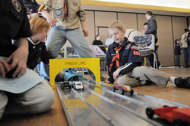 Cub Scouts watch cars finish durng the fun races at Saturday's Pinewood Derby competition for Cub Scout Troop 586 held at the Broomfield Community Center.<br /> January 22, 2011<br /> staff photo/David R. Jennings