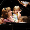 Michelle Hoffman holds her daughter Loryn Hoffman, 21, months-old, during Saturday's Cuddle Time Concert with professional pianist Jamie Grigsby playing Bach, Mozart, and Mother Goose at the Broomfield Audi.<br /> July 11, 2009<br /> staff photo/David R. Jennings