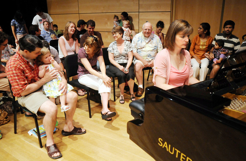 Cuddle Time Concert with professional pianist Jamie Grigsby, right,  playing Bach, Mozart, and Mother Goose at the Broomfield Audi.<br /> July 11, 2009<br /> staff photo/David R. Jennings