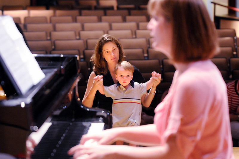 Gail Sawchuk listens with her son Peter Levi, 15 months-old, as professional pianist Jamie Grigsby plays Bach, Mozart, and Mother Goose during the Cuddle Time Concert at the Broomfield Audi.<br /> July 11, 2009<br /> staff photo/David R. Jennings