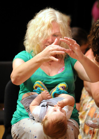 """Mary Lee Vice gestures to her grandson Jayden Vice, 9 months-old,  during the son """"Itsty bitsy spider"""" at  Saturday's Cuddle Time Concert with professional pianist Jamie Grigsby playing Bach, Mozart, and Mother Goose at the Broomfield Audi.<br /> July 11, 2009<br /> staff photo/David R. Jennings"""