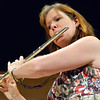 Morag Barrett plays the flute during the Cuddle Time Concert with the Broomfield Symphony Orchestra on Saturday.<br /> <br /> July 14, 2012<br /> staff photo/ David R. Jennings