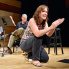 Morag Barrett demonstrates that clapping can be a percussion instrument to the audience during the Cuddle Time Concert with the Broomfield Symphony Orchestra on Saturday.<br /> <br /> July 14, 2012<br /> staff photo/ David R. Jennings