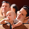 Adam Finkle, 10 months-old, with his mother Eva Pataki, right, and father Steve, left, watches members of the Broomfield Symphony Orchestra play their instruments during the Cuddle Time Concert at the Audi on Satuday.<br /> July 14, 2012<br /> staff photo/ David R. Jennings
