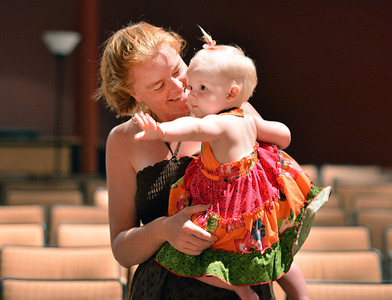 Kamron Bouchard and her daughter Automn, 1, stand as they listen to music being played by members of the Broomfield Symphony Orchestra during the Cuddle Time Concert at the Audi on Saturday.  July 14, 2012 staff photo/ David R. Jennings