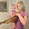 ryan Howard, right, looks at a trumpet with her daughter Cora, 15 months-old, after the Cuddle Time Concert with the Broomfield Symphony Orchestra on Saturday.<br /> <br /> July 14, 2012<br /> staff photo/ David R. Jennings<br /> <br /> Ryan Howard and her daughter Cora, 15 months-old, 5ur5-u<br /> \