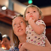 Kim Polz and her daughter Stella, 14 months-old, watch members of  the Broomfield Symphony Orchestra play their instruments during the Cuddle Time Concert at the Audi on Saturday.<br /> <br /> <br /> July 14, 2012<br /> staff photo/ David R. Jennings