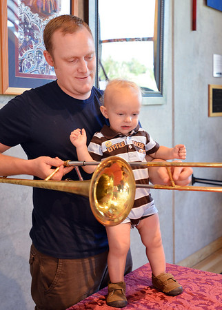 Charles Howard and his son Charlie, 15 months-old, look at a trombone after the Cuddle Time Concert with the Broomfield Symphony Orchestra on Saturday.<br /> <br /> July 14, 2012<br /> staff photo/ David R. Jennings