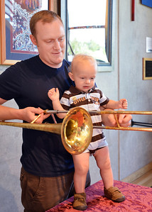 Charles Howard and his son Charlie, 15 months-old, look at a trombone after the Cuddle Time Concert with the Broomfield Symphony Orchestra on Saturday.  July 14, 2012 staff photo/ David R. Jennings