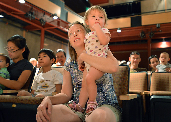 Kim Polz and her daughter Stella, 14 months-old, watch members of  the Broomfield Symphony Orchestra play their instruments during the Cuddle Time Concert at the Audi on Saturday.<br /> <br /> July 14, 2012<br /> staff photo/ David R. Jennings