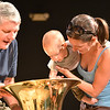Adam Finkle, 10 months-old, with the help of his mother Eva Pataki, looks into the top of Philip Houha's tuba after  the Cuddle Time Concert with the Broomfield Symphony Orchestra on Saturday.<br /> July 14, 2012<br /> staff photo/ David R. Jennings