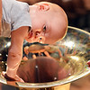 Adam Finkle, 10 months-old, looks at a tuba after the Cuddle Time Concert with the Broomfield Symphony Orchestra on Saturday.<br /> <br /> July 14, 2012<br /> staff photo/ David R. Jennings