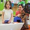 Olivia Mraz, 4, left, and her mother Julie look at a computer showing a traditional story from Indian during Goddard School's cultural day on Friday.<br /> April 1, 2011<br /> staff photo/David R. Jennings