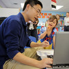David Zhu shows Morgan Beltzer, 4, pictures of China during Goddard School's cultural day on Friday.<br /> April 1, 2011<br /> staff photo/David R. Jennings