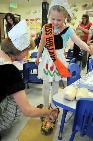 Maya Walker, 6,  tries on cloths and wooden shoes from Holland with the help of Marian Short during Goddard School's cultural day on Friday.<br /> April 1, 2011<br /> staff photo/David R. Jennings